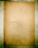 Vintage paper on grungy background. Old worn paper on grungy background; excellent detail stock photos