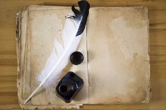 Vintage paper with ink feather and inkwell. A Vintage paper with ink feather and inkwell Royalty Free Stock Photo