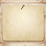Vintage paper nailed on a wooden wall with shelves Stock Image