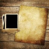 Vintage paper and photo on wood background Stock Photo