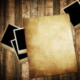 Vintage paper and photo on wood background Stock Photography