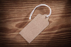 Vintage paper price tag label on old wooden boards Royalty Free Stock Photos