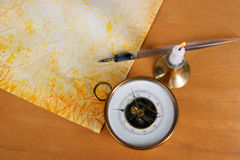 Vintage paper with quill pen. A candle and a barometer royalty free stock photos