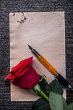 Vintage paper red bloomed rose fountain pen on Royalty Free Stock Photos