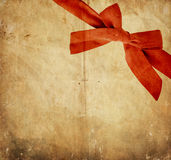 Vintage paper with red bow Stock Images