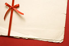 Vintage paper with red bow Royalty Free Stock Images
