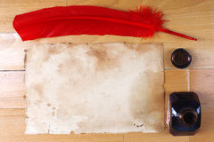 Vintage paper with red feather pen and inkwell Royalty Free Stock Images