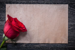 Vintage paper red natural scented rosebud on wood board Royalty Free Stock Photos