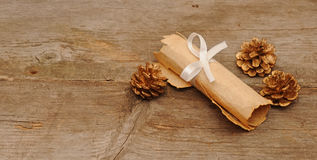 Vintage paper roll with gold cones Stock Image