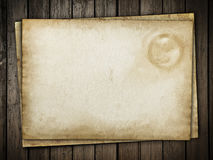 Vintage paper sheet at wood. Background Royalty Free Stock Photo