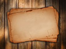 Vintage paper sheets at wood. Background Royalty Free Stock Image