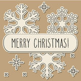 Vintage paper snowflakes and Merry Christmas Stock Photography