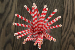 Vintage paper straws in glass on wood table Stock Photos