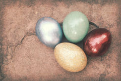 Vintage paper texture, Colorful easter eggs on stone floor Royalty Free Stock Image