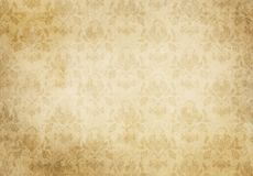 Vintage paper texture with floral patterns. Old yellowed paper texture with decorative vintage patterns. Old wallpaper for background royalty free illustration