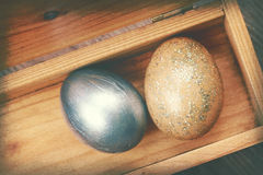 Vintage paper texture, Two easter eggs in wood box Stock Photos