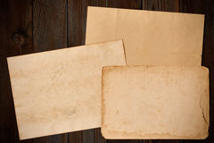 Vintage paper on textured old wooden background Stock Images