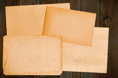 Vintage paper on textured old wooden background Stock Photography