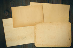 Vintage paper on textured old wooden background Royalty Free Stock Photo