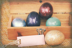 Vintage paper textures, Colorful easter egg in wood box with paper tag Royalty Free Stock Photography
