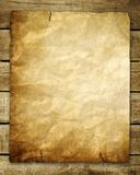 Vintage paper on wood background Stock Photo