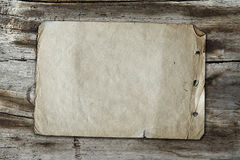 Vintage paper on wood texture Stock Image