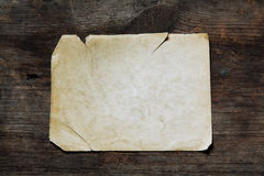 Vintage paper on wood texture Royalty Free Stock Image