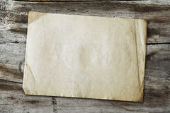 Vintage paper on wood texture Royalty Free Stock Photography