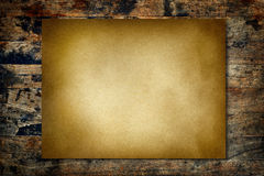 Vintage paper on wood wall Stock Photo