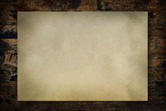 Vintage paper on wood wall Royalty Free Stock Photos