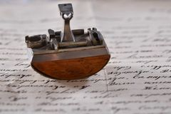 Vintage paperweight on the love letter royalty free stock photography