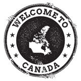 Vintage passport welcome stamp with Canada map. Stock Photos