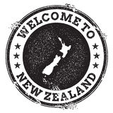 Vintage passport welcome stamp with New Zealand. Vintage passport welcome stamp with New Zealand map. Grunge rubber stamp with Welcome to New Zealand text Royalty Free Stock Image