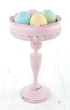Vintage pastel color easter eggs in old vase Royalty Free Stock Photo
