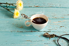 Vintage pastel color tone style of coffee cup  and stainless spoon on blue wooden Royalty Free Stock Image