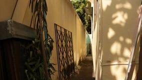 Vintage Pastel Narrow Alley Between Walls stock image