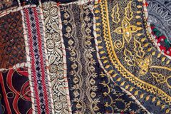 Vintage patchwork background on retro handmade carpet. Patterns on texture of old blanket surface.  stock photography