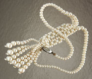 Vintage pearl necklace. Beautiful vintage white pearl necklace with reflections Stock Image
