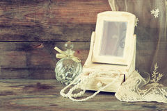 Vintage pearls , antique wooden jewelry box with mirror and perfume bottle Royalty Free Stock Photo