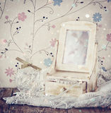 Vintage pearls , antique wooden jewelry box with mirror and perfume bottle on wooden table. filtered image Royalty Free Stock Images