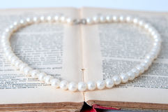Vintage pearls and books royalty free stock photo