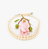 Vintage Pearls with pink rose Royalty Free Stock Image
