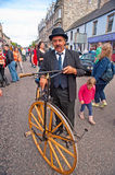 Vintage pedal bike at Grantown-on-Spey. Roy Wilson of Dingwall stands beside his Royalty Free Stock Photos