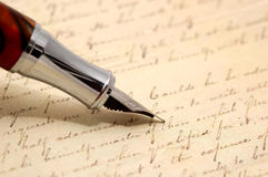 Vintage pen. And old letter in background Stock Photos
