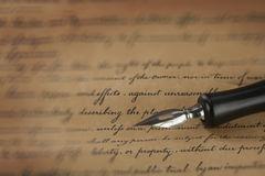 A vintage pen on a handwritten paper Stock Photo