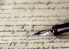 A vintage pen on a handwritten paper Stock Photography
