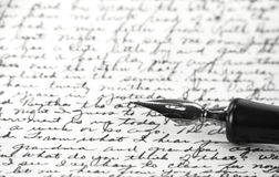 A vintage pen on a handwritten paper Stock Images