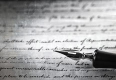 A vintage pen on a handwritten paper Royalty Free Stock Photos