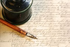 Vintage Pen and Inkwell. Old nib pen and inkwell, with background of 19th century writing royalty free stock images