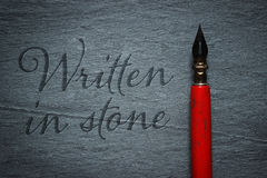 Vintage pen written in stone Royalty Free Stock Photo